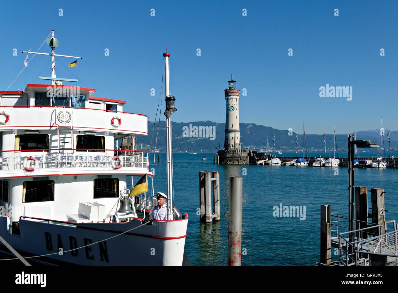 Ferry boat crewman setting flag, Lindau, Swabia, Bavaria, Germany, Europe Stock Photo