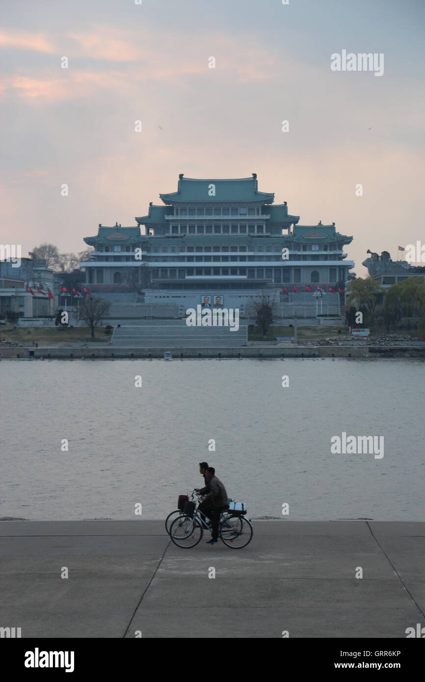 Cyclists in Pyongyang, North Korea - Stock Image