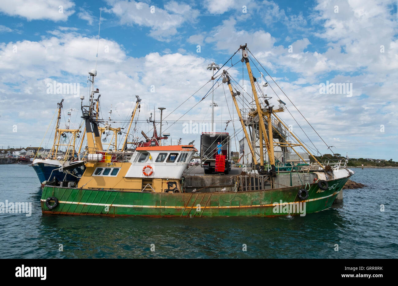 fishing trawler unloading catch port harbour quay - Stock Image