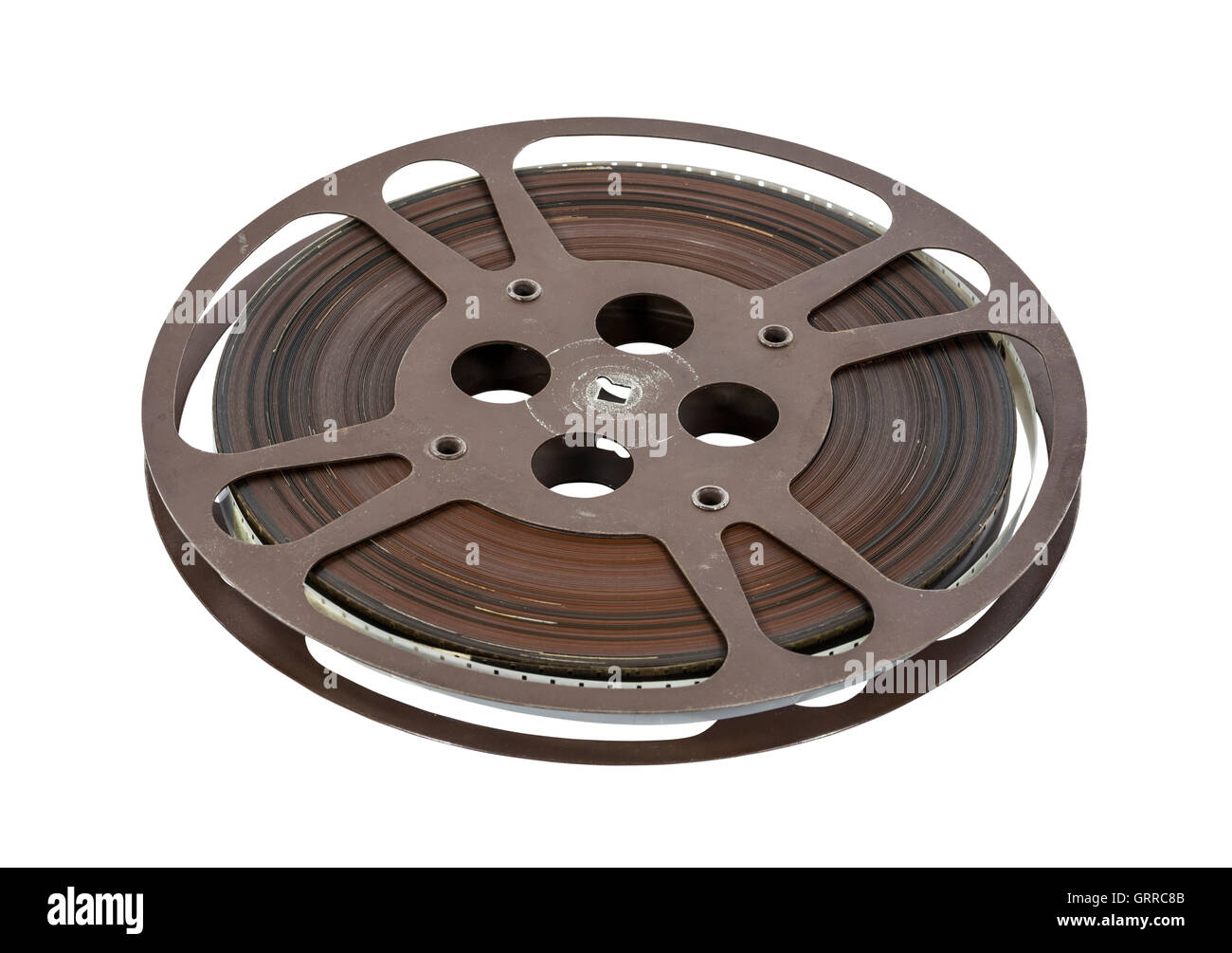 Old 16 mm movie film reel isolated on white. - Stock Image