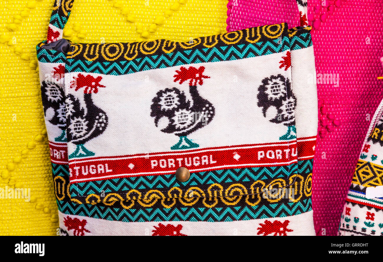 Rooster Bags Textiles Colorful Handicrafts 11th Century Medieval Town Obidos Portugal.  Rooster is the symbol of - Stock Image