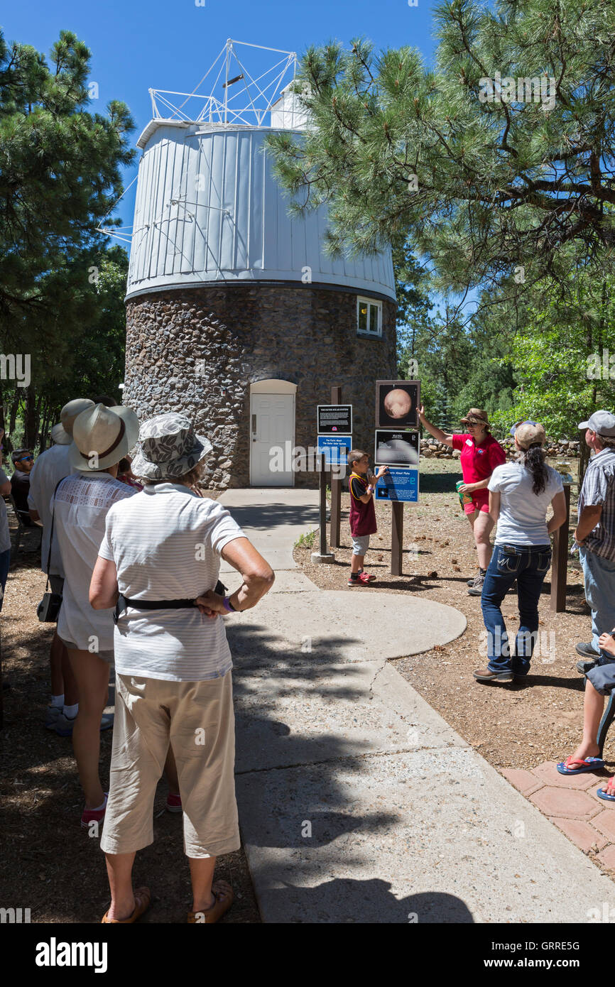 Flagstaff, Arizona - A guide tells visitors to the Lowell Observatory about the Pluto Telescope Dome. - Stock Image