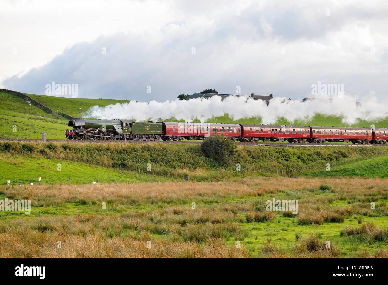 Flying Scotsman steam train on an embankment. Gilsland, Newcastle & Carlisle Railway (N&CR), Cumbria, England, - Stock Image