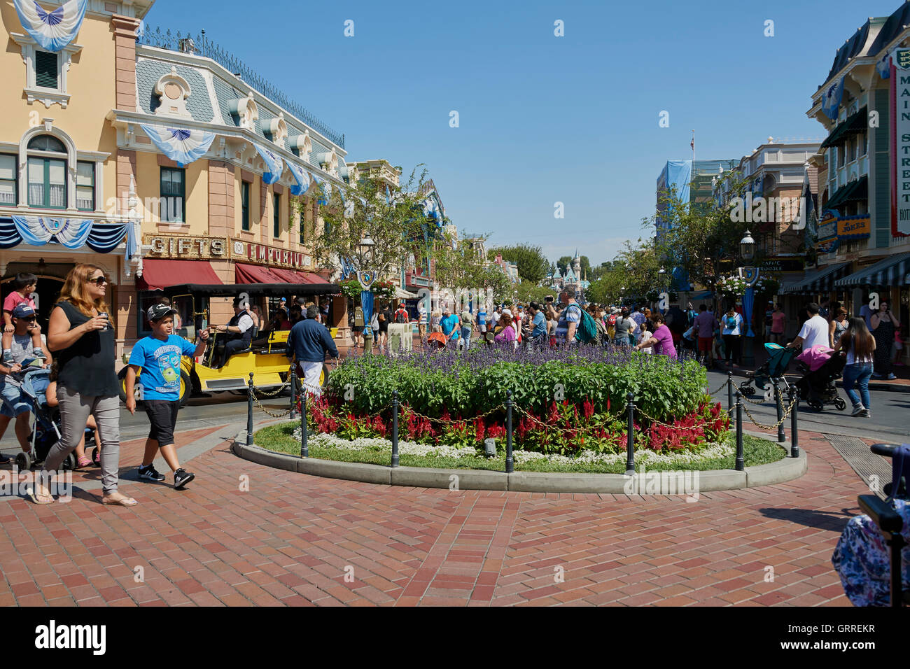 Main Street in Disney California USA with crowds of people on a really hot day. - Stock Image