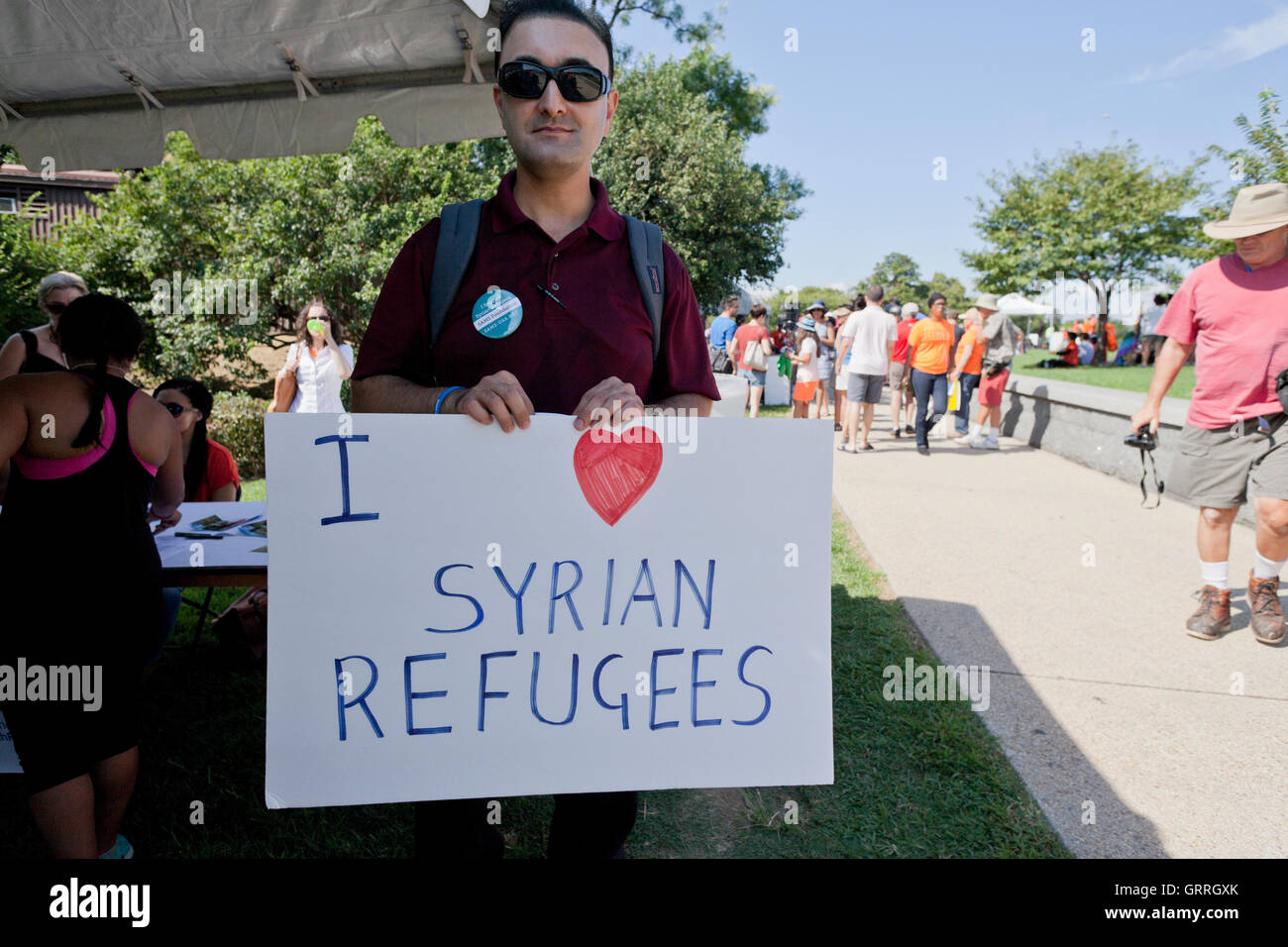 Syrian refugee supporter holding sign - Washington, DC USA - Stock Image