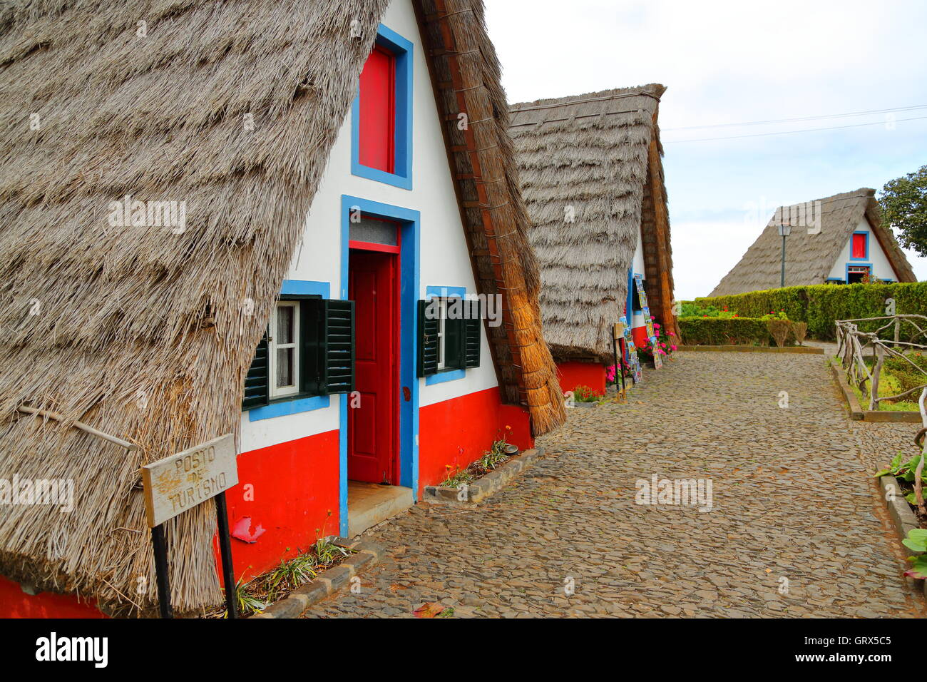 Typical houses in Santana in the north of the Portuguese island of Madeira - Stock Image