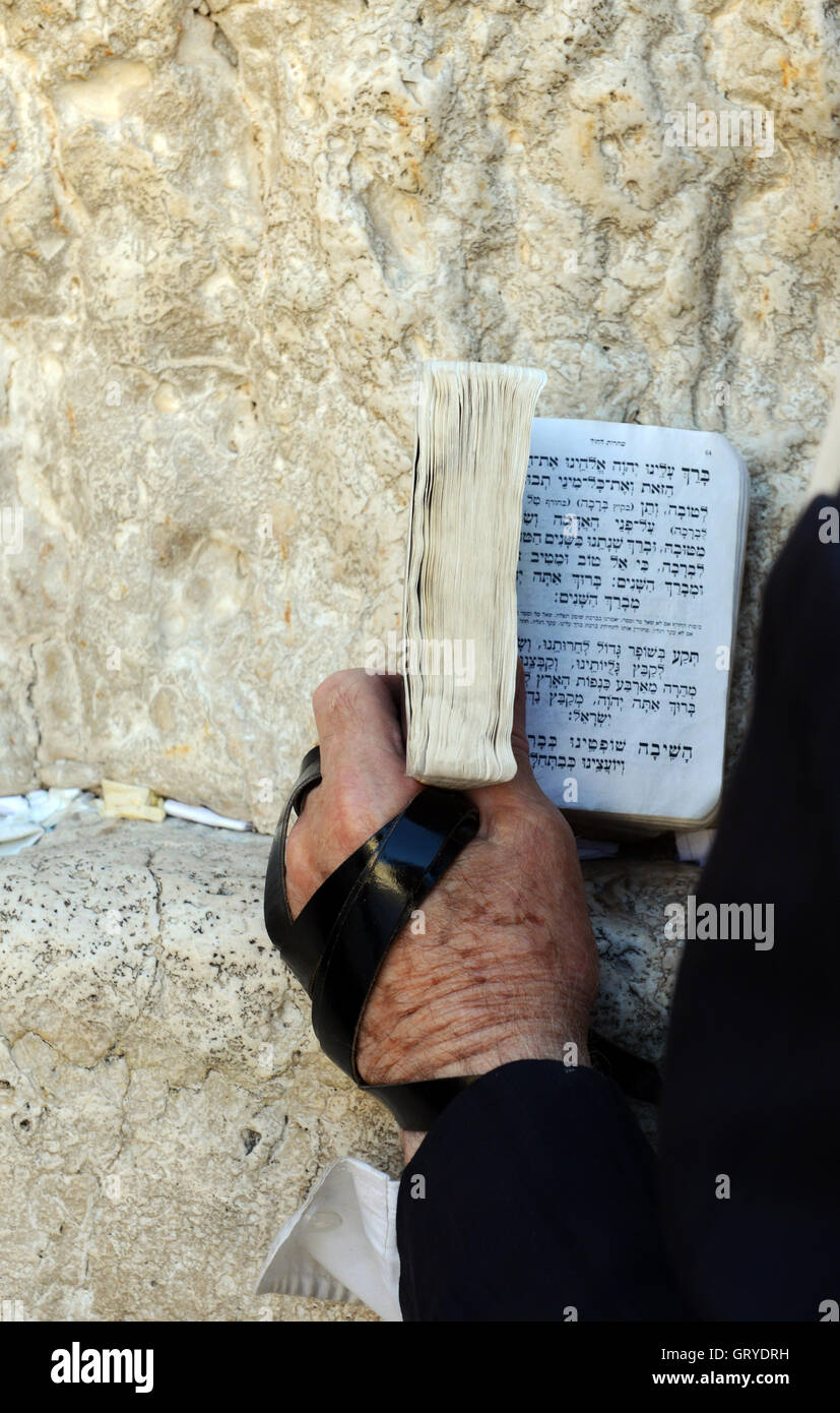 Jewish men praying by the Wailing wall in the old city of Jerusalem. - Stock Image