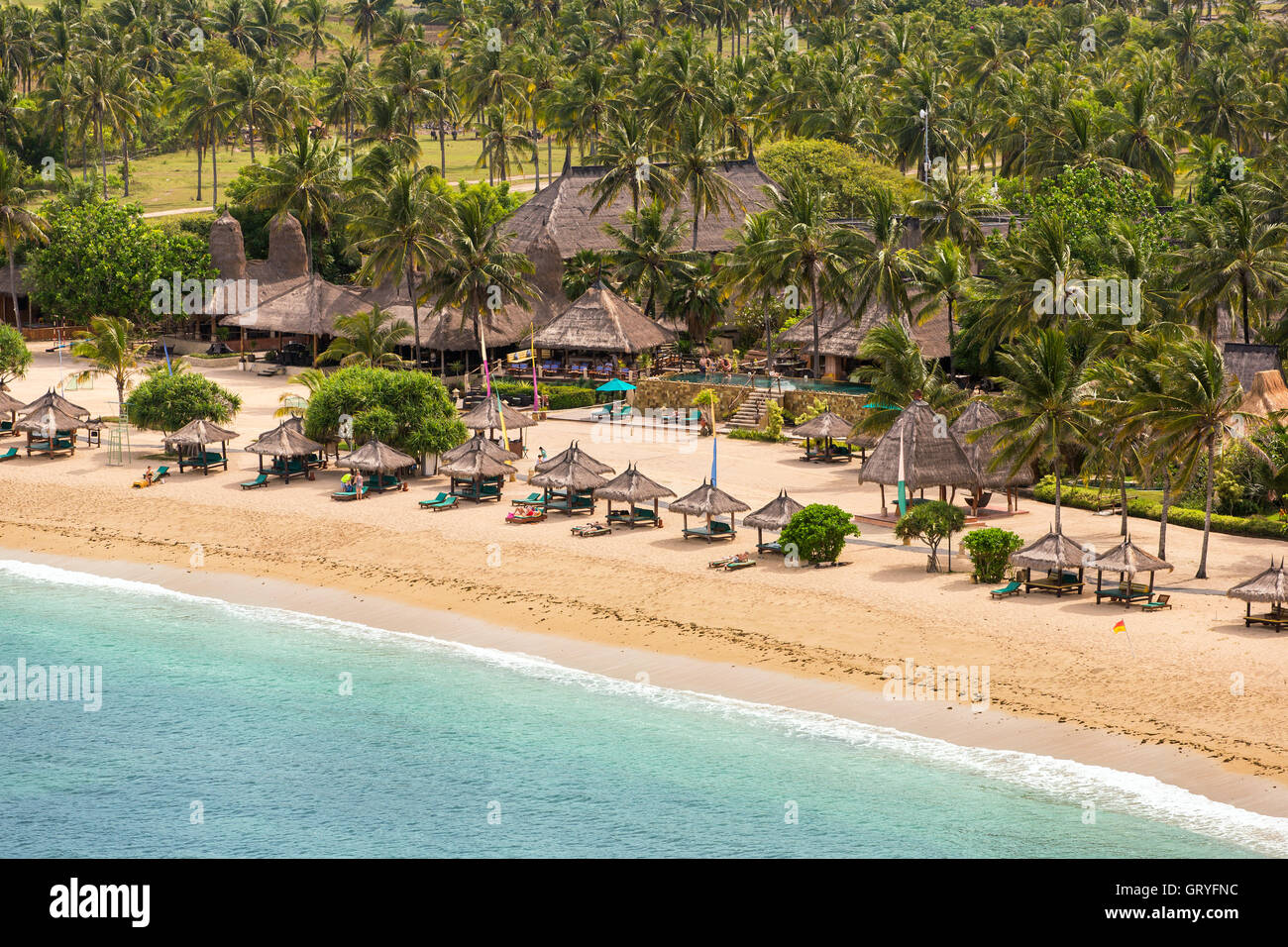 Tropical resort on Kuta sand beach, Lombok, Indonesia - Stock Image