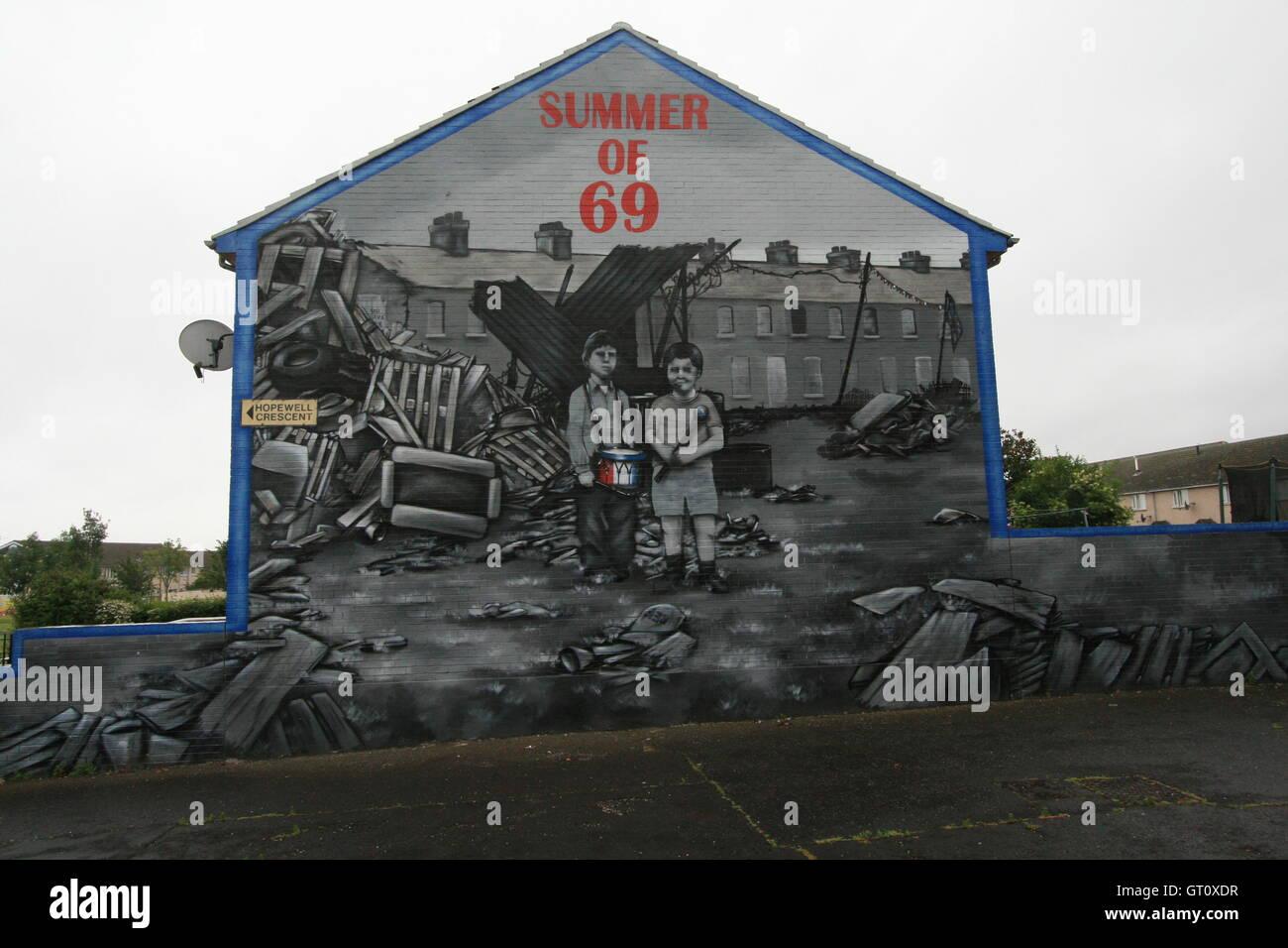 Unionist political mural commemorating 1969 Northern Ireland riots, Shankill Road, Belfast, Northern Ireland, UK. - Stock Image