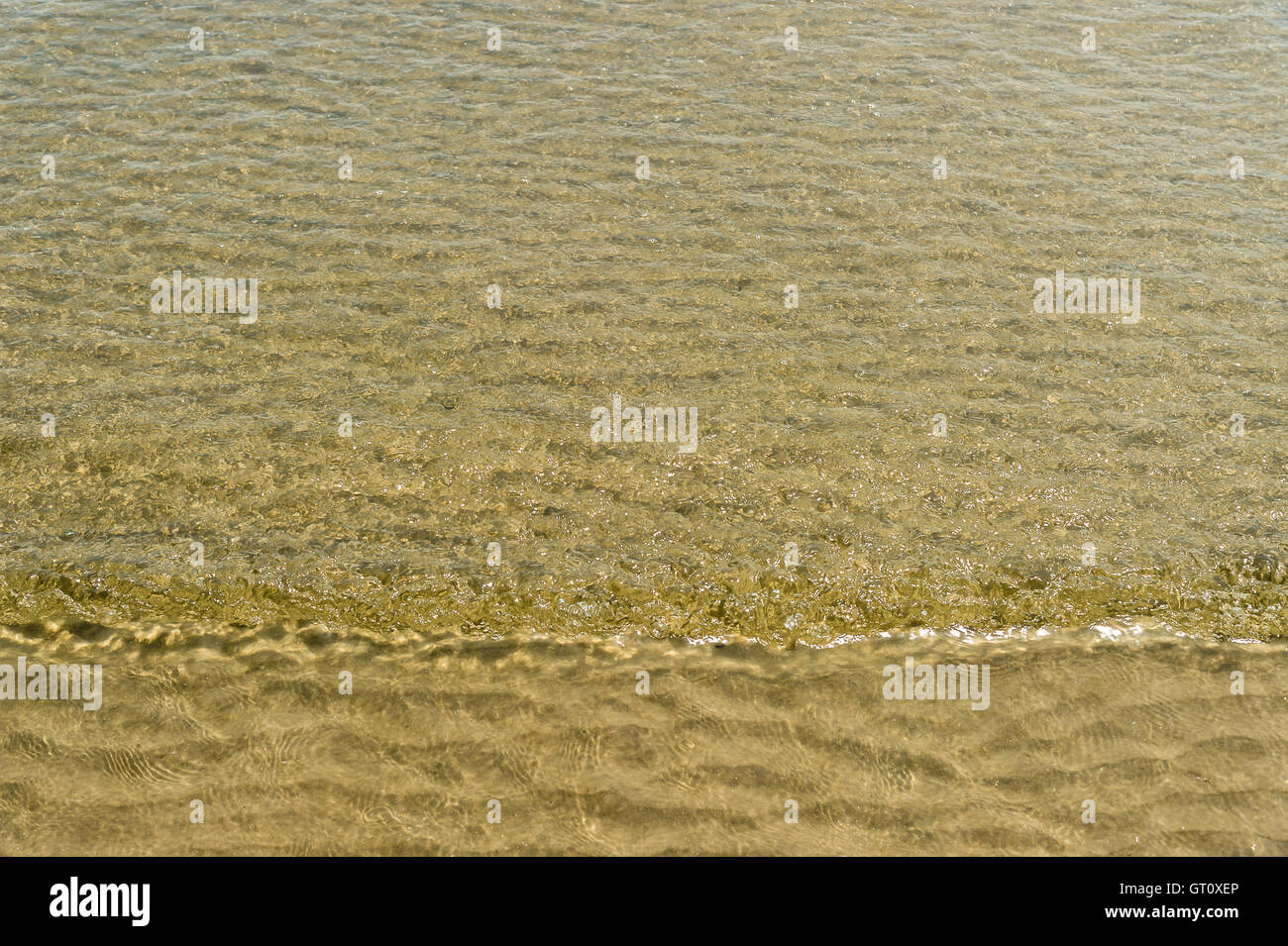 transparent water ripple wave track on beach - Stock Image