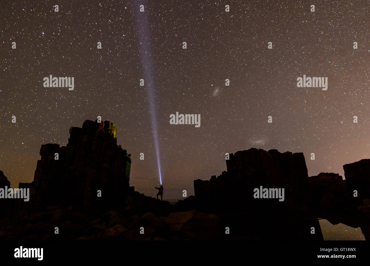 Person beaming to the stars, Bombo Headland Quarry,New South Wales, NSW, Australia - Stock Image