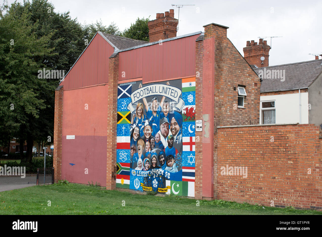 A mural painted on the side of a house in Tudor Road Leicester depicting world football - Stock Image