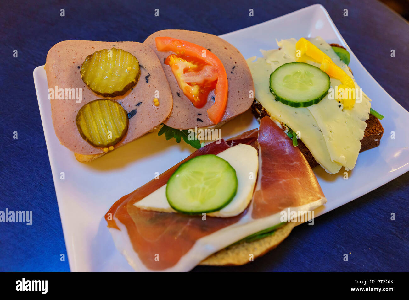 Traditional Sweden style breakfast sandwich with tomato, ham, cucumber and pickle - Stock Image