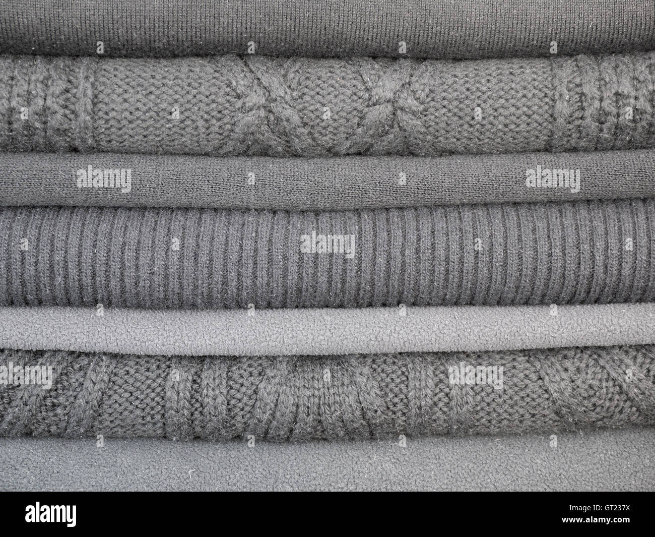 Cold weather clothes in different shades of gray and different textures - Stock Image