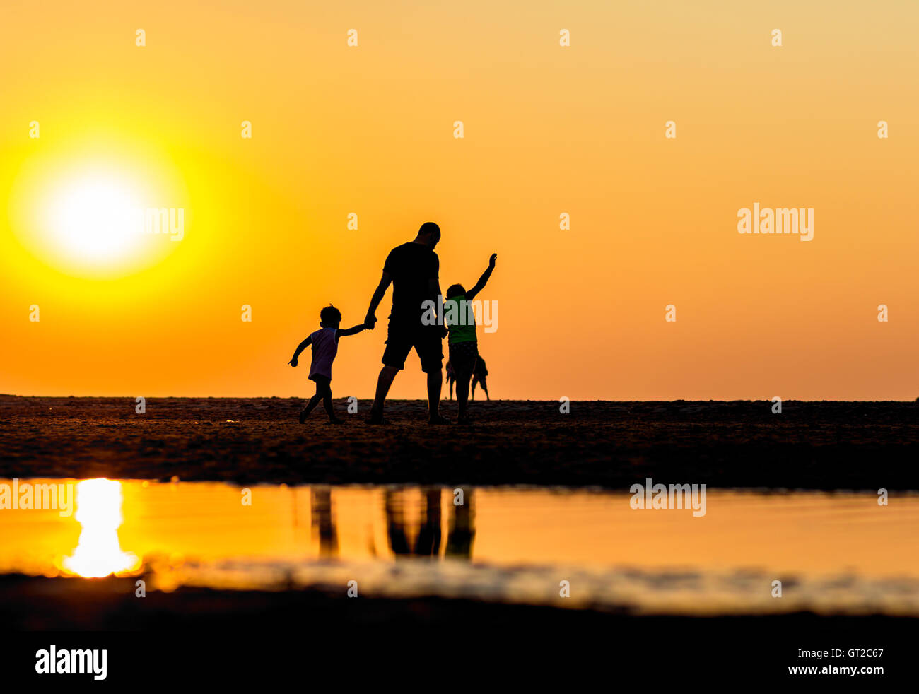 Kijkduin beach, the Netherlands - September 07, 2016: father and children on the beach during warmest September - Stock Image