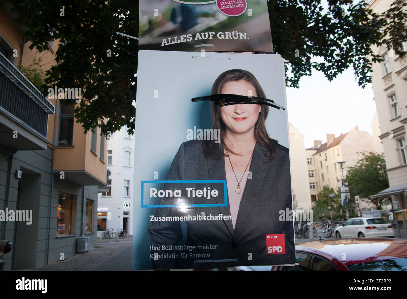 defaced election poster Berlin Germany - Stock Image