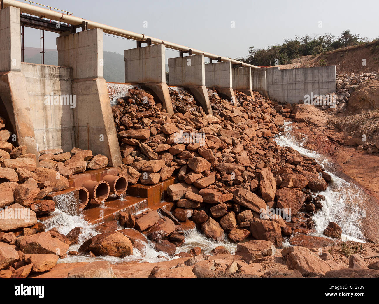 Mining operations for producing and managing iron ore. Newly built dam and weir providing new water resource for Stock Photo