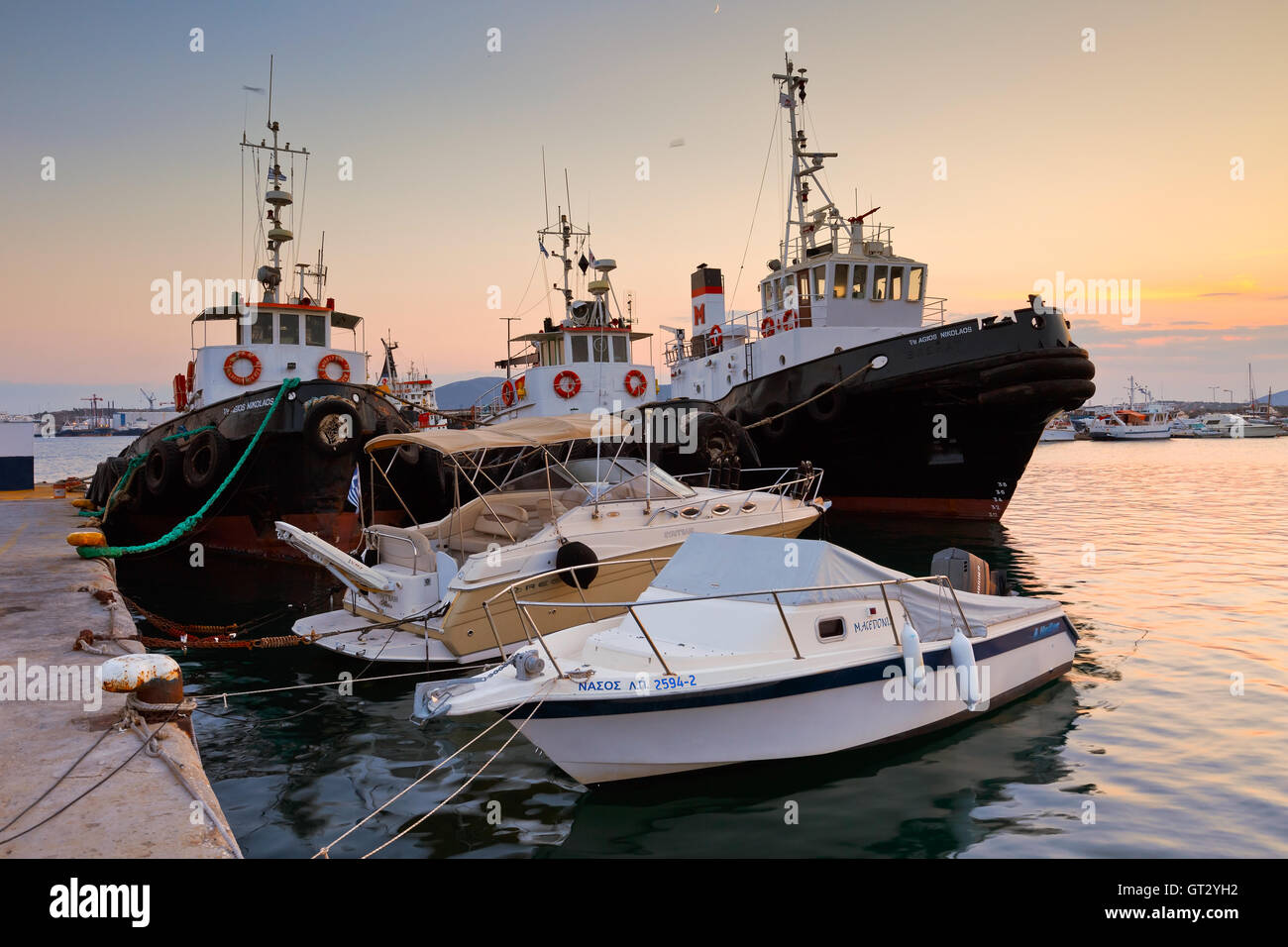 Tugs and motor boats in the port of Perama, Athens. - Stock Image