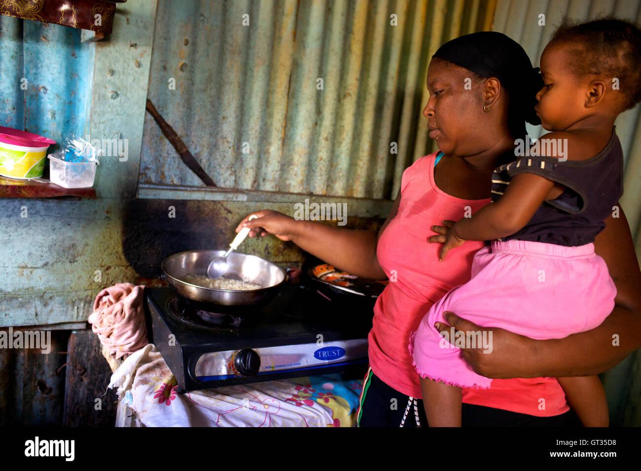 Chagos -  06/04/2012  -  Mauritius  -  Meri Elysee, chagos refugee in her kitchen, Baie du Tombeau, Mauritius   Stock Photo