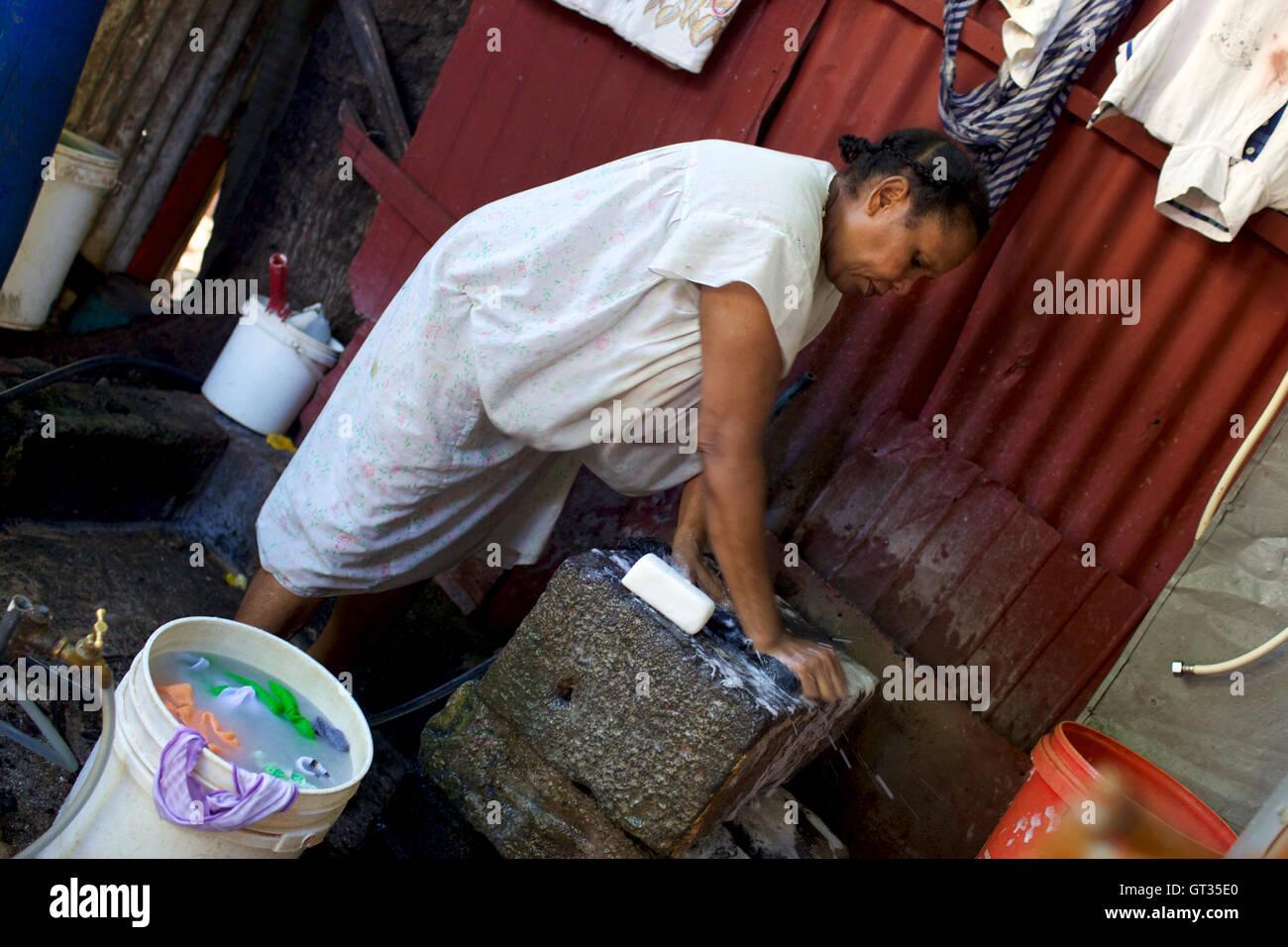 Chagos -  04/04/2012  -  Mauritius  -  Meri Elysee, chagos refugee in her kitchen, Baie du Tombeau, Mauritius   Stock Photo