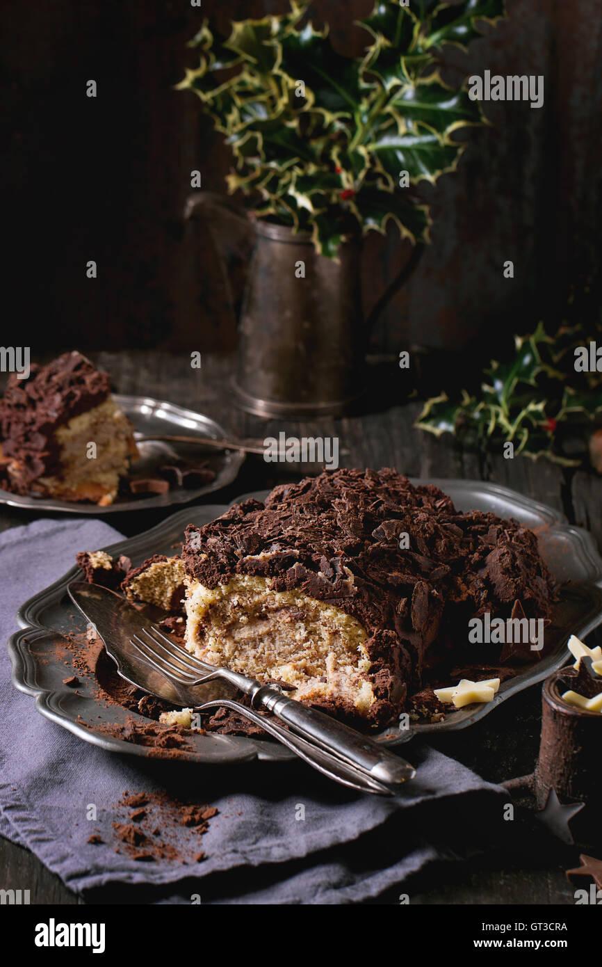 Sliced christmas chocolate yule log Stock Photo