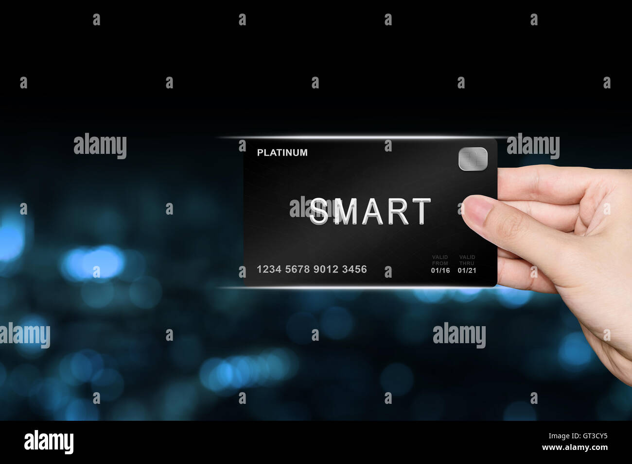hand picking smart platinum card on blur background - Stock Image