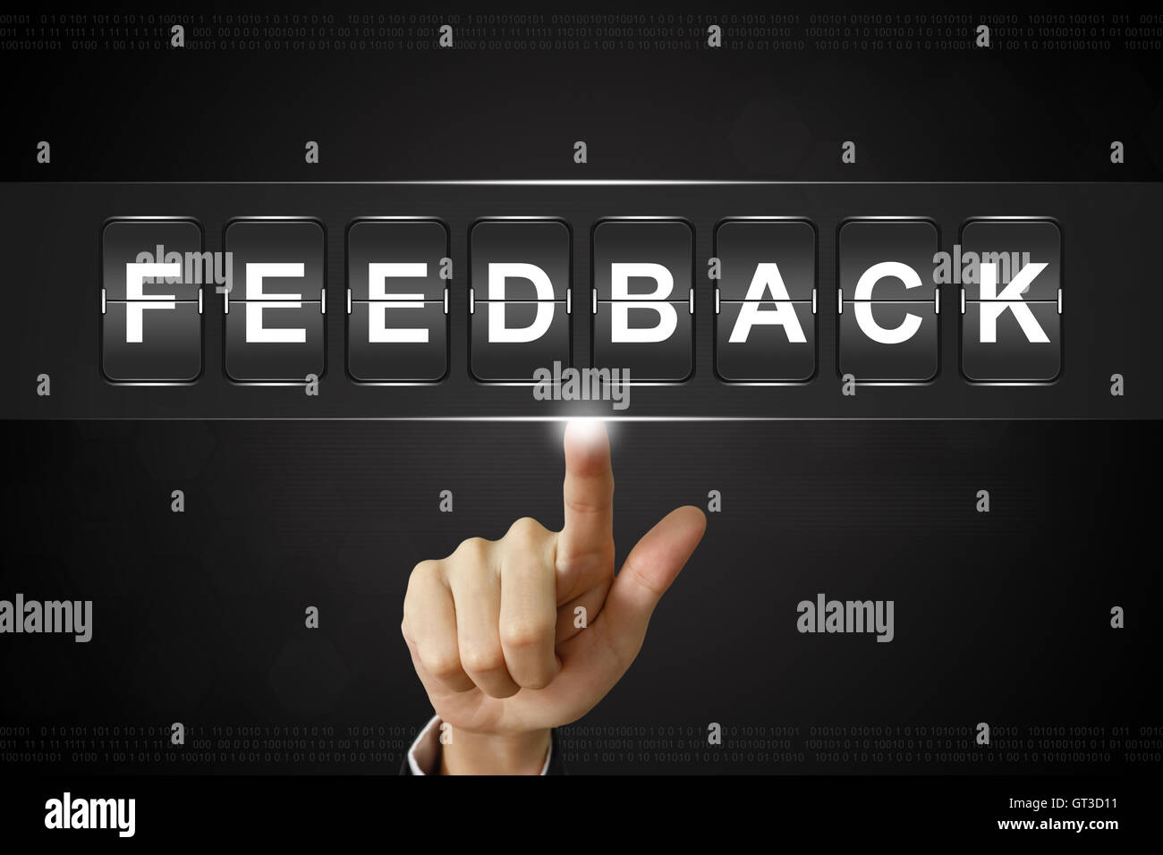 business hand pushing feedback on Flipboard Display - Stock Image