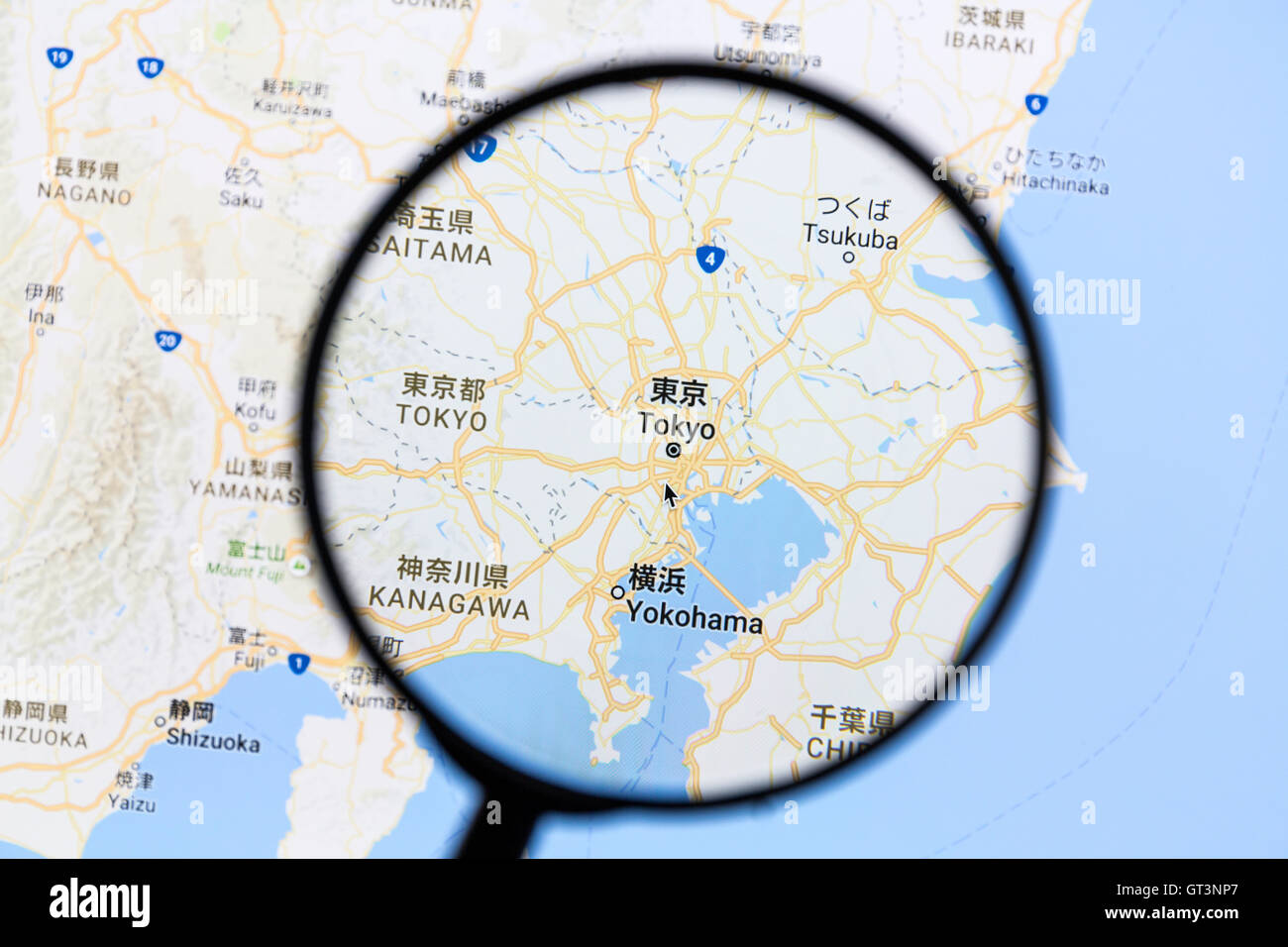 Tokyo on Google Maps under a magnifying glass Stock Photo: 118096895 ...