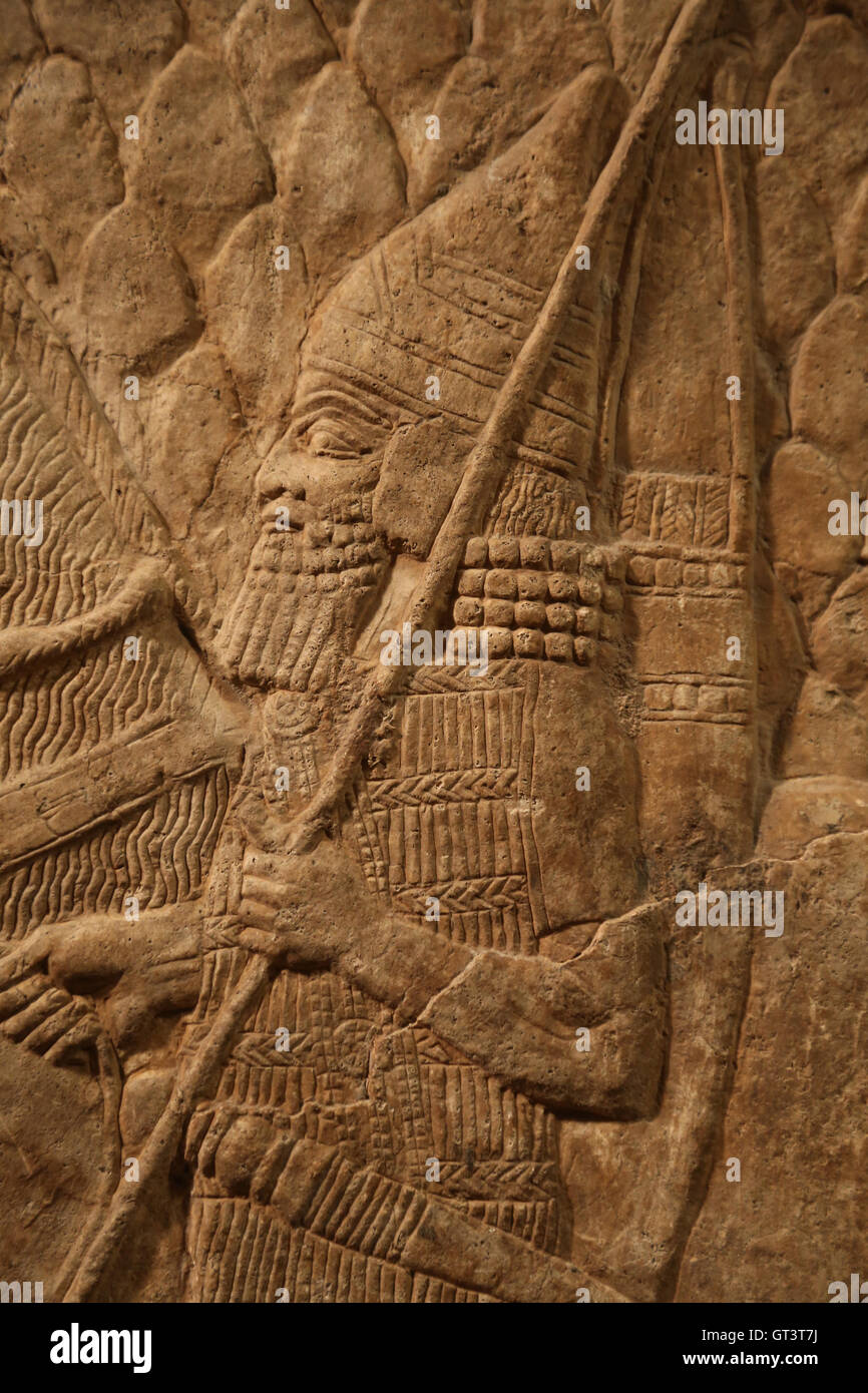 Fragment of relief. Assyrian horse trappings. Cavalrymen. Detail. Ca. 704-681 B.C. - Stock Image