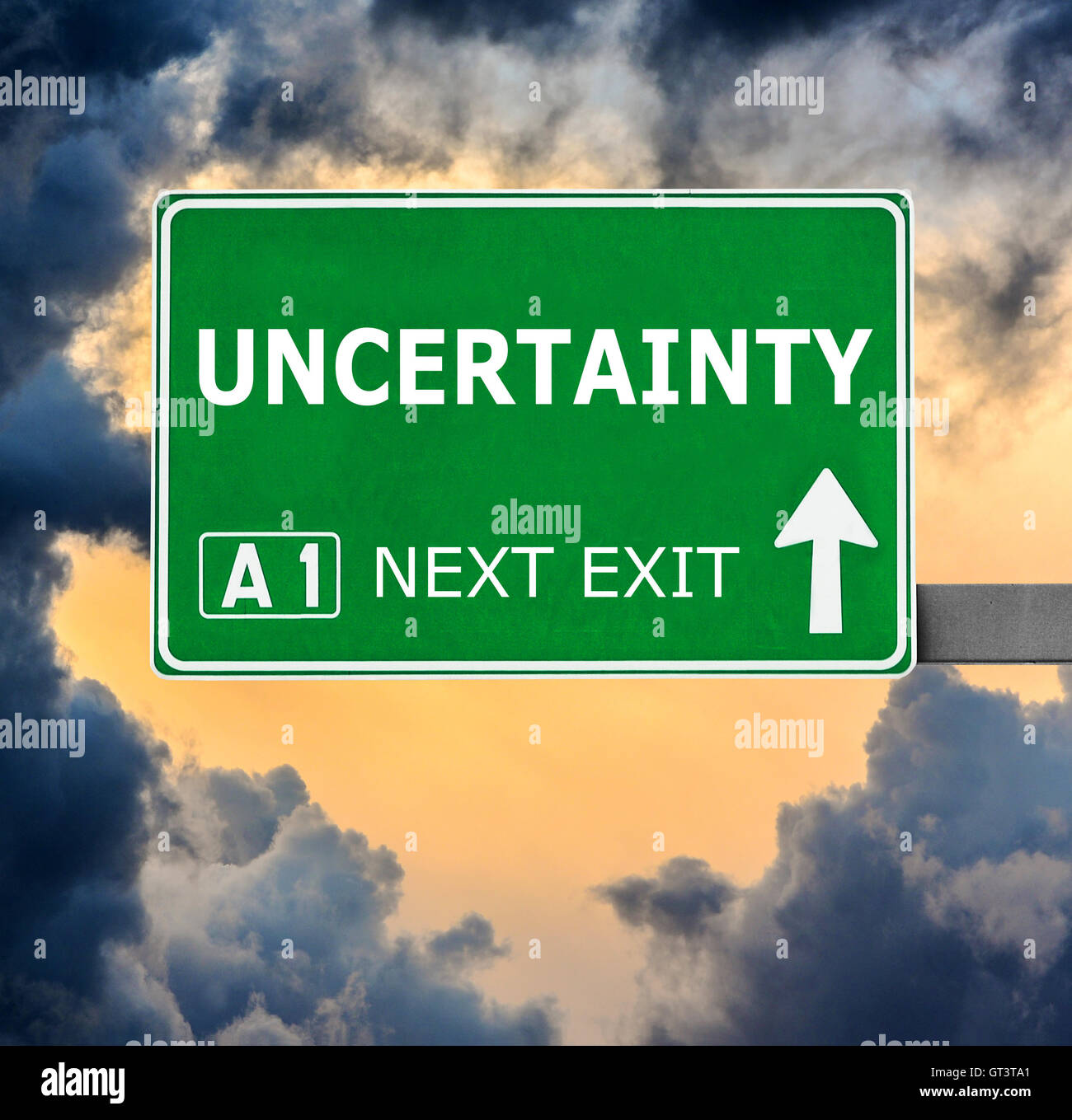 UNCERTAINTY road sign against clear blue sky Stock Photo