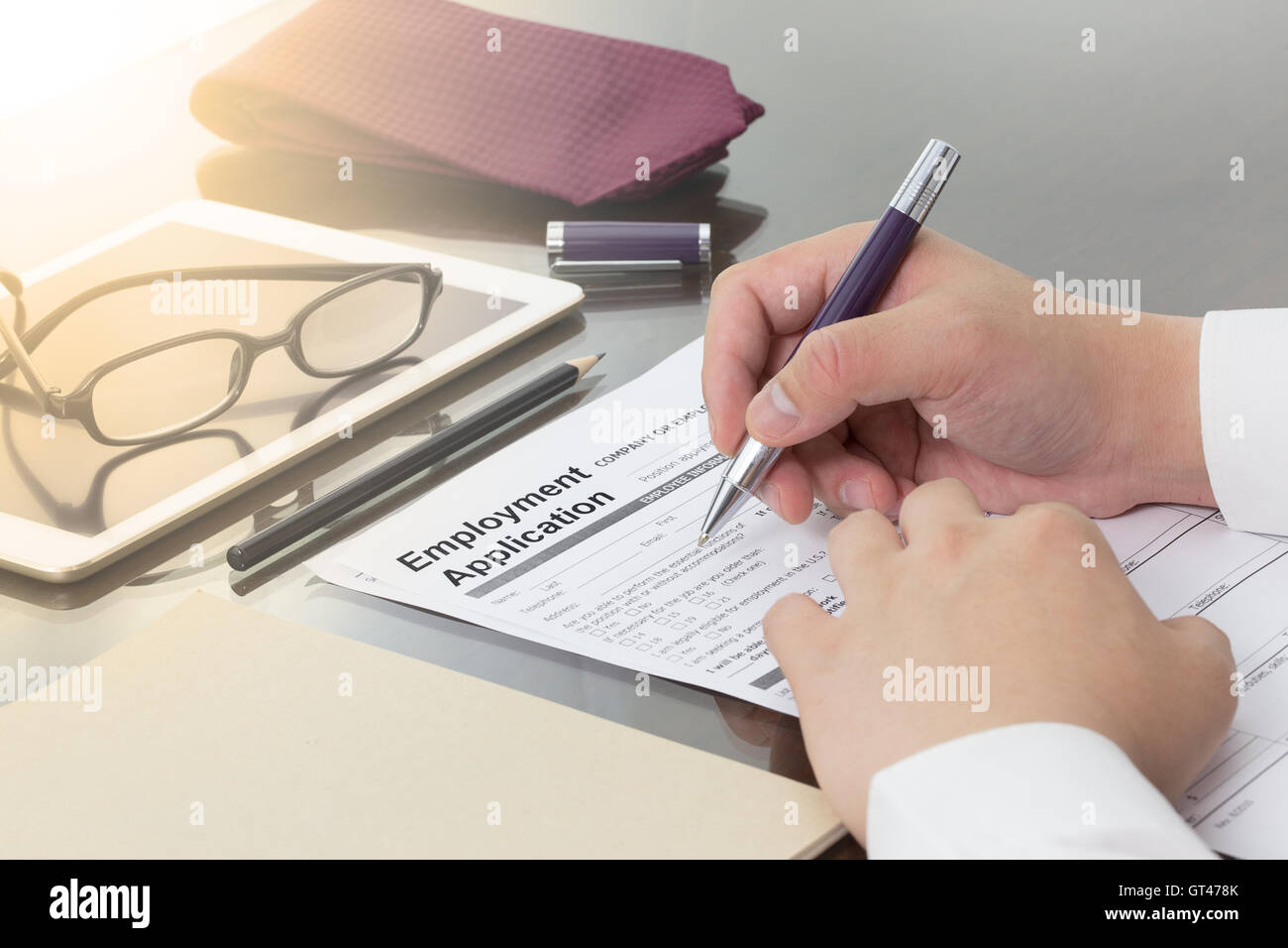 Businessman or job seeker fill in Employment Application form with pen. job vacancy concept. Stock Photo