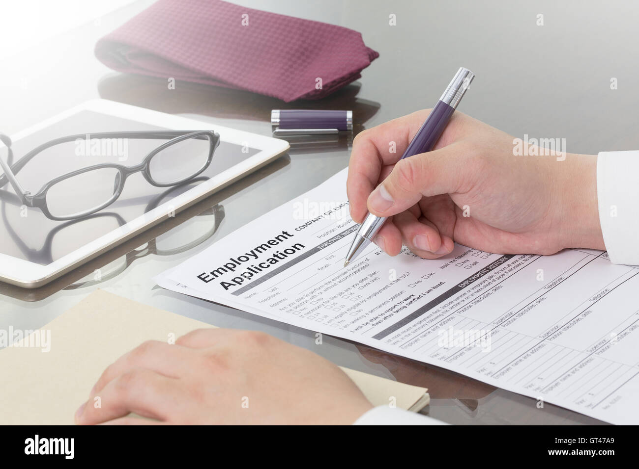 Businessman or job seeker fill in Employment Application form with ...