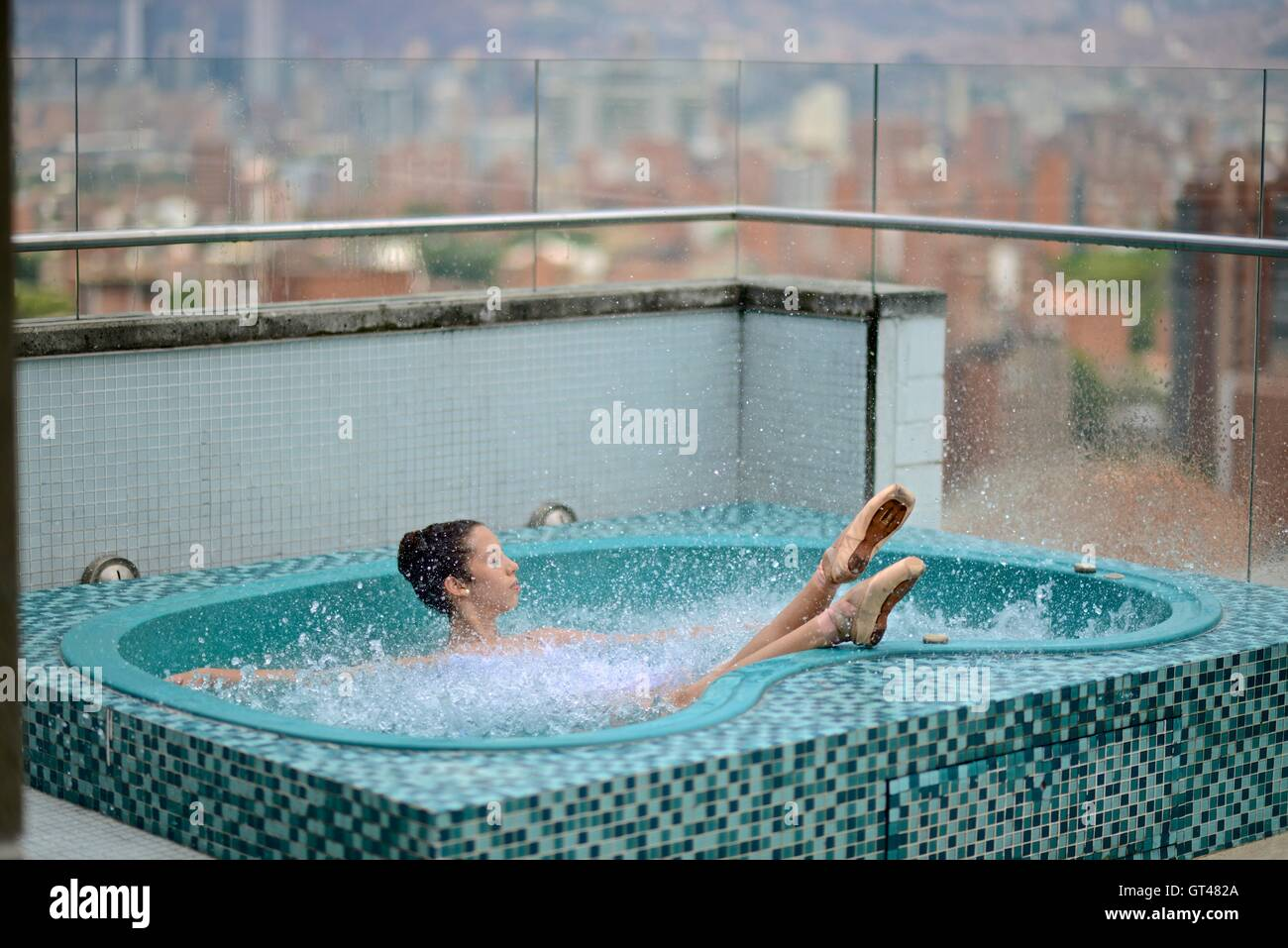 Ballerina in a rooftop jacuzzi in Medellin. - Stock Image