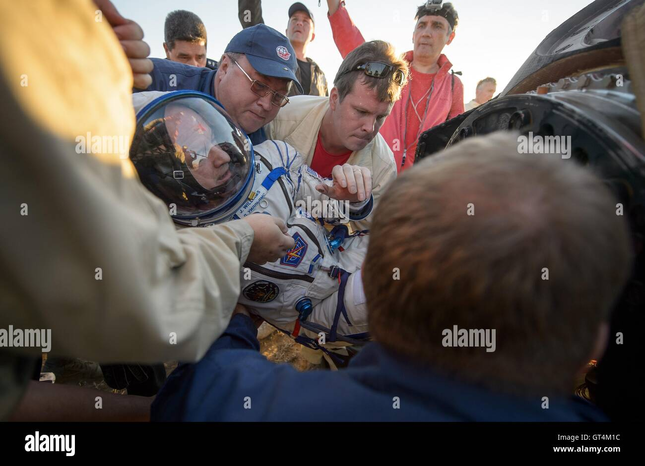 International Space Station Expedition 48 NASA astronaut Jeff Williams is helped out of the Soyuz TMA-20M spacecraft - Stock Image