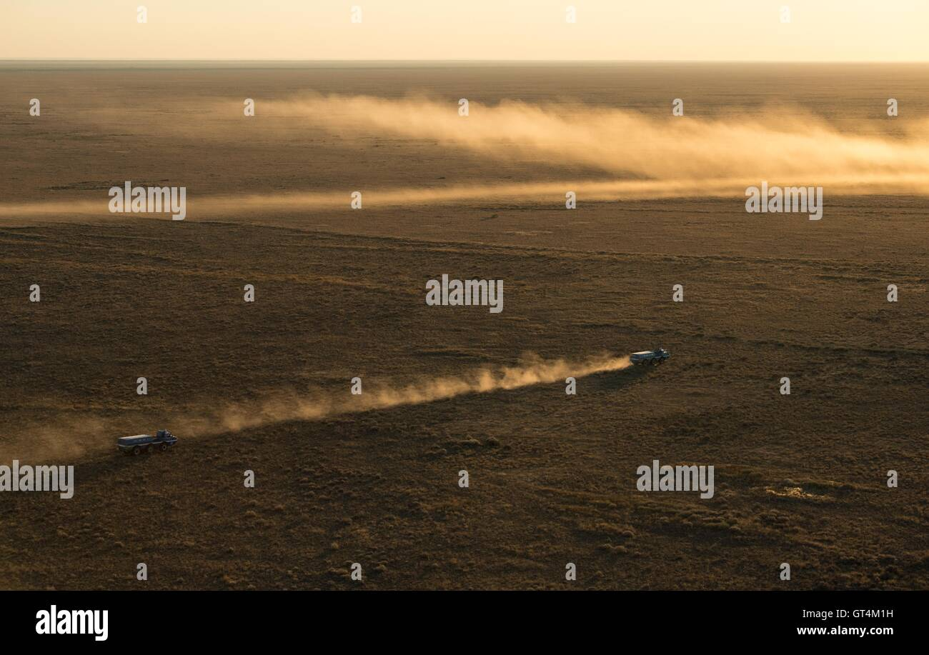 Russian Search and Rescue teams arrive at the Soyuz TMA-20M spacecraft shortly after landing with International - Stock Image