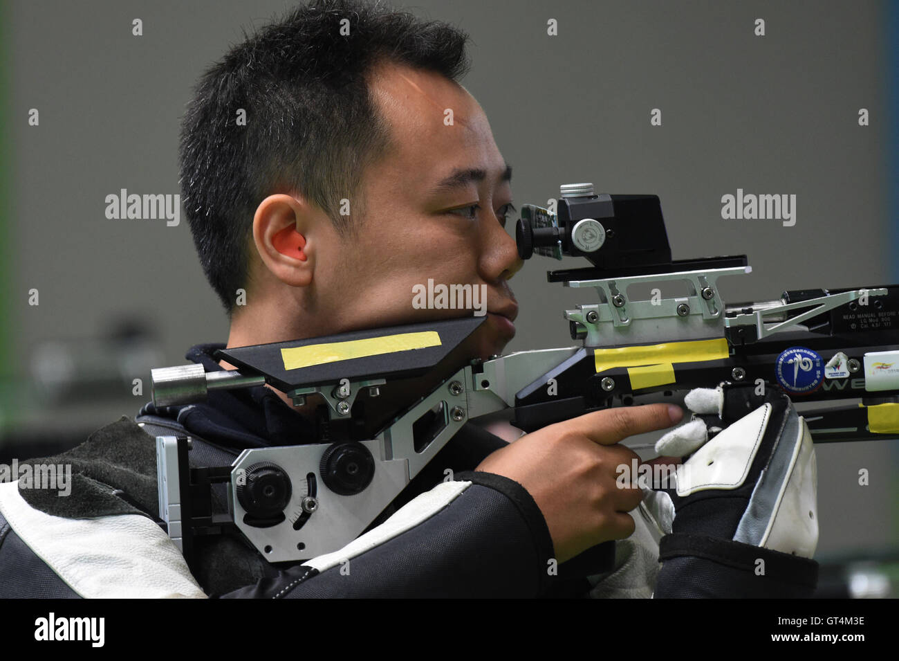 Rio De Janeiro. 8th Sep, 2016. Dong Chao of China competes during Men's R1 10m Air Rifle Standing SH1 Final - Stock Image