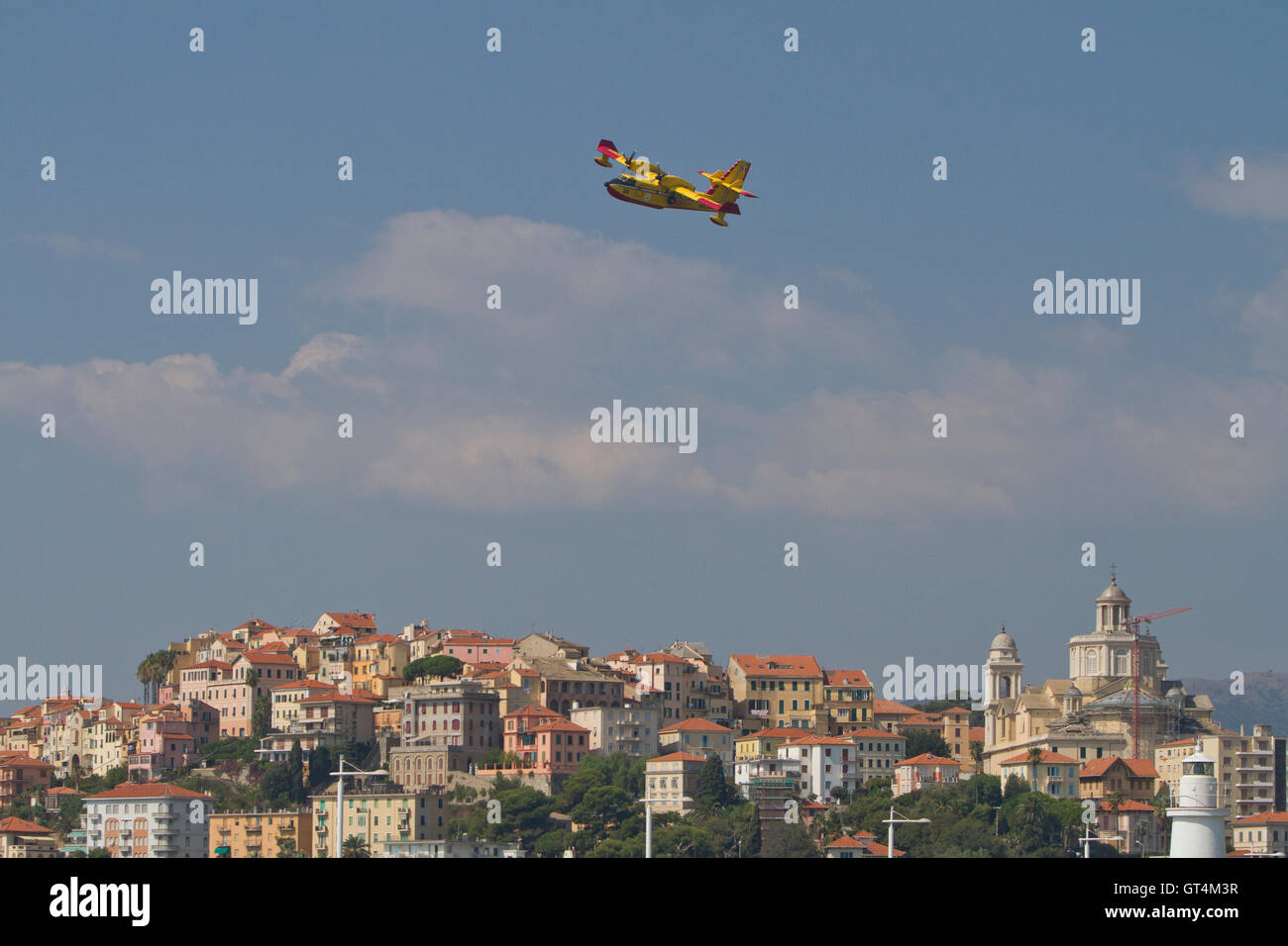 Imperia, Italy. 8th September 2016. A water bomber aircraft Bombardier 415 (Canadair) flyes over Imperia (Italy) - Stock Image
