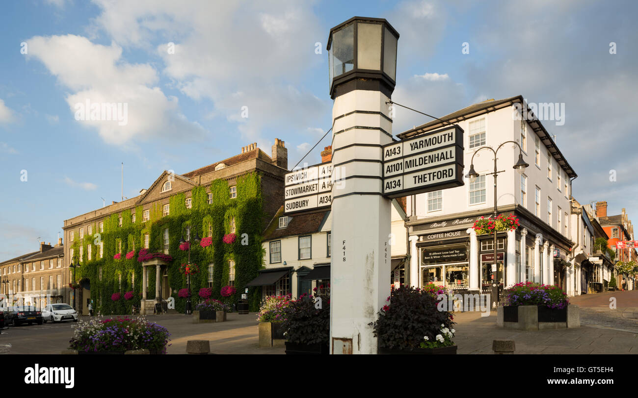 Angel Hotel and old salt pillar traffic sign at Angel Hill, Bury Saint Edmunds, Suffolk, which is a popular tourist - Stock Image