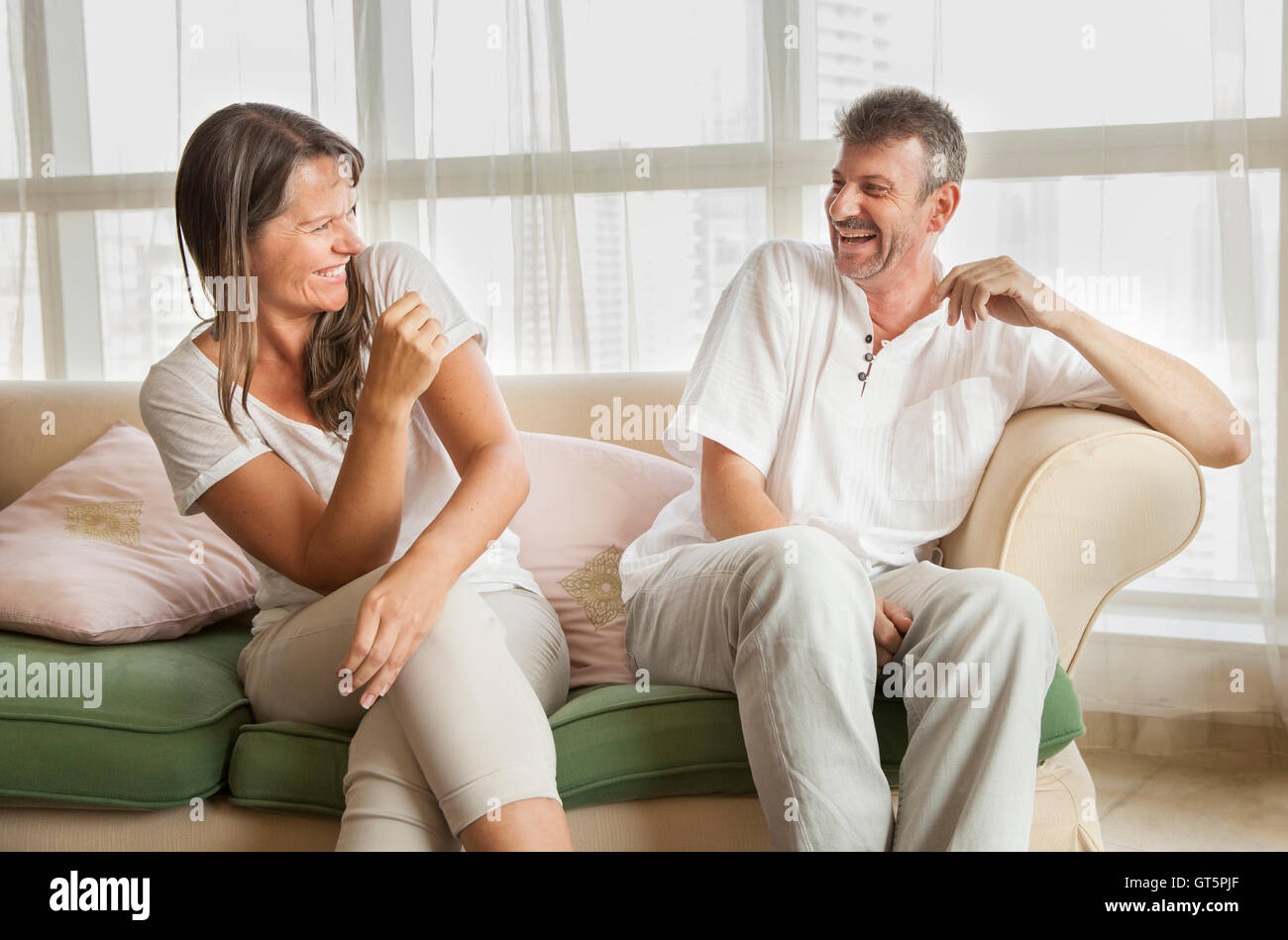 middle aged couple laughing - Stock Image