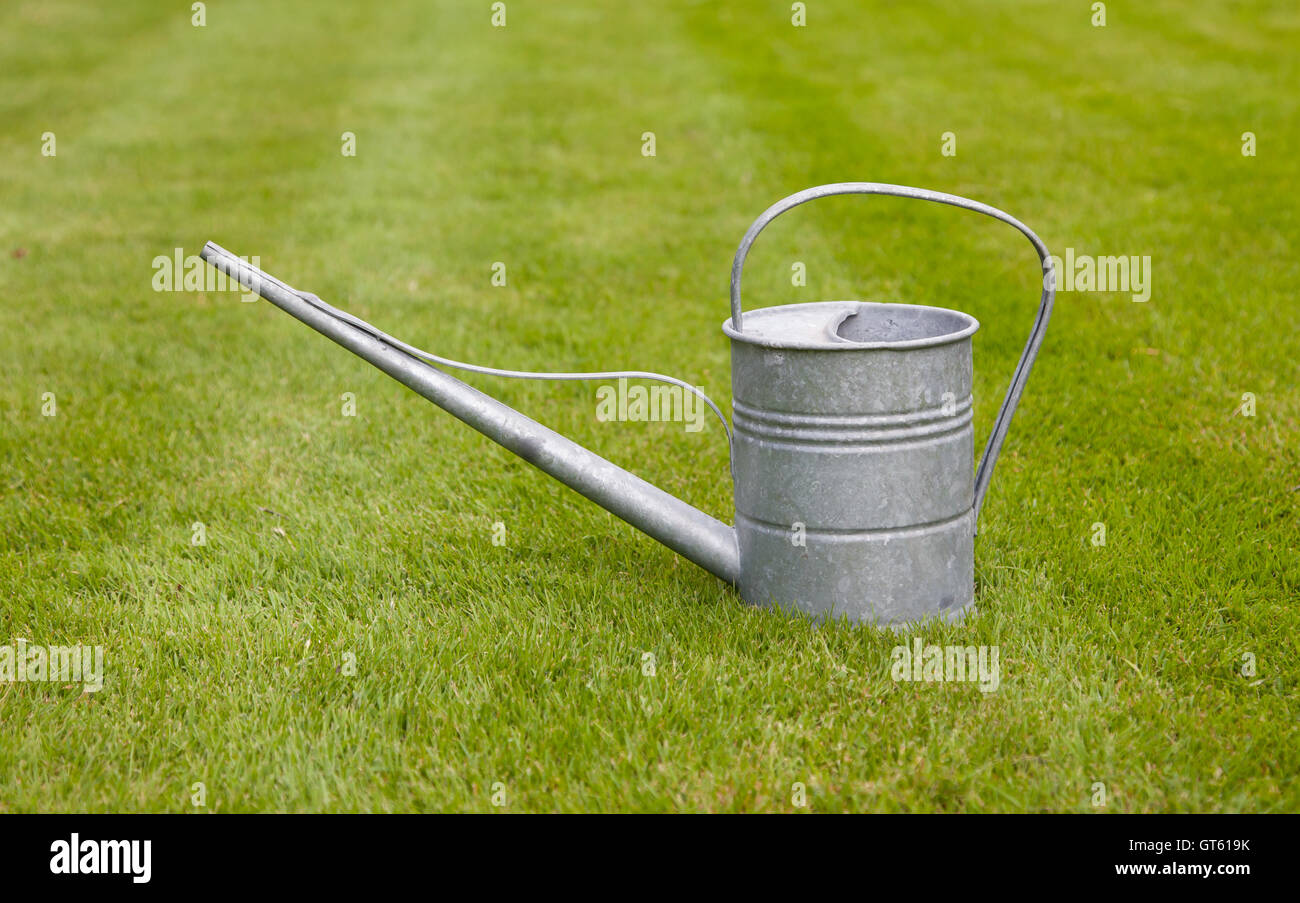 Very old metal watering-can - Stock Image