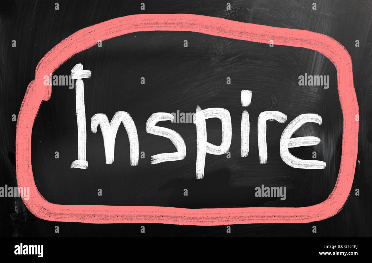 Inspire handwritten with chalk on a blackboard - Stock Image