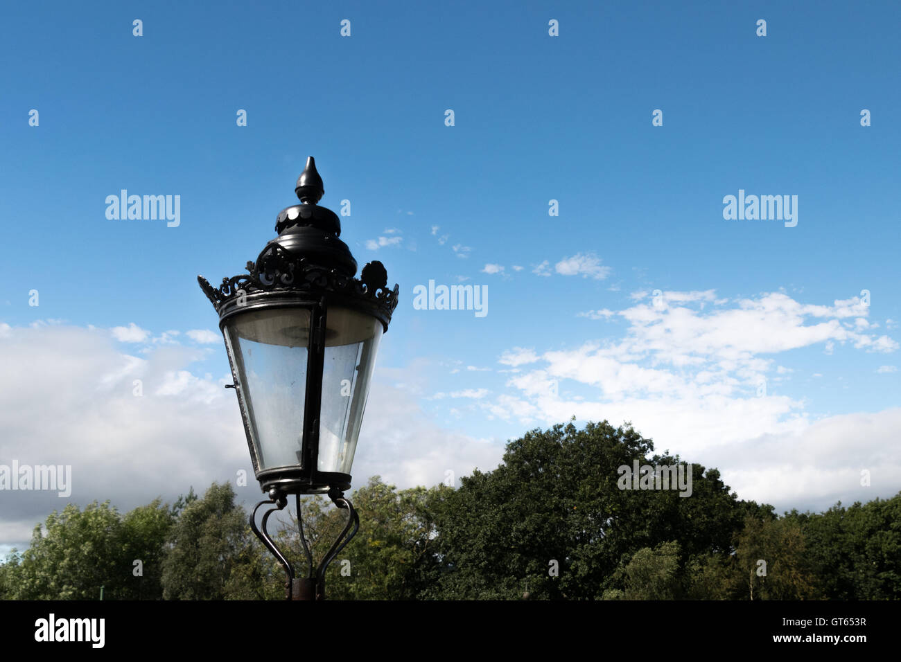 Ornate iron lamp and blue sky at Beamish museum - Stock Image