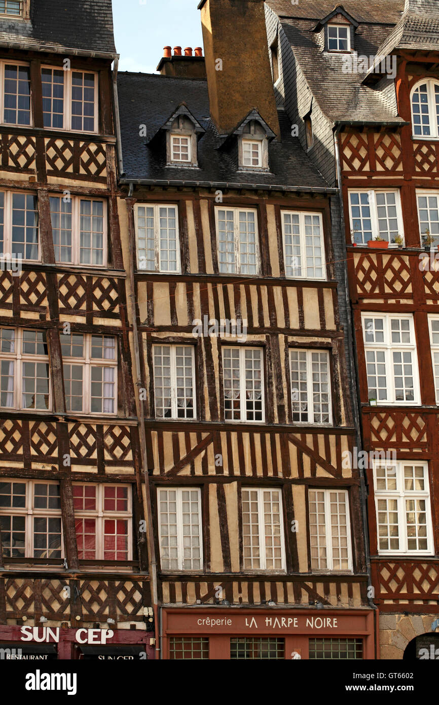Typical half timbered gabled buildings in the old part of Rennes, Brittany, France. Crooked, leaning, slippage with Stock Photo