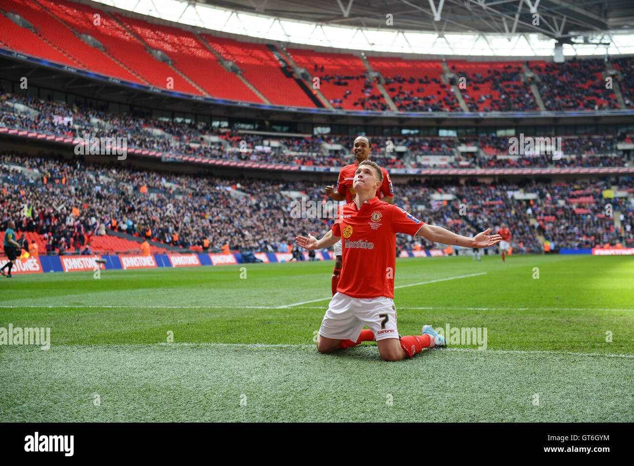 Footballer Max Clayton celebrates scoring for Crewe Alexandra in Johnstone's Paint Trophy at Wembley - Stock Image