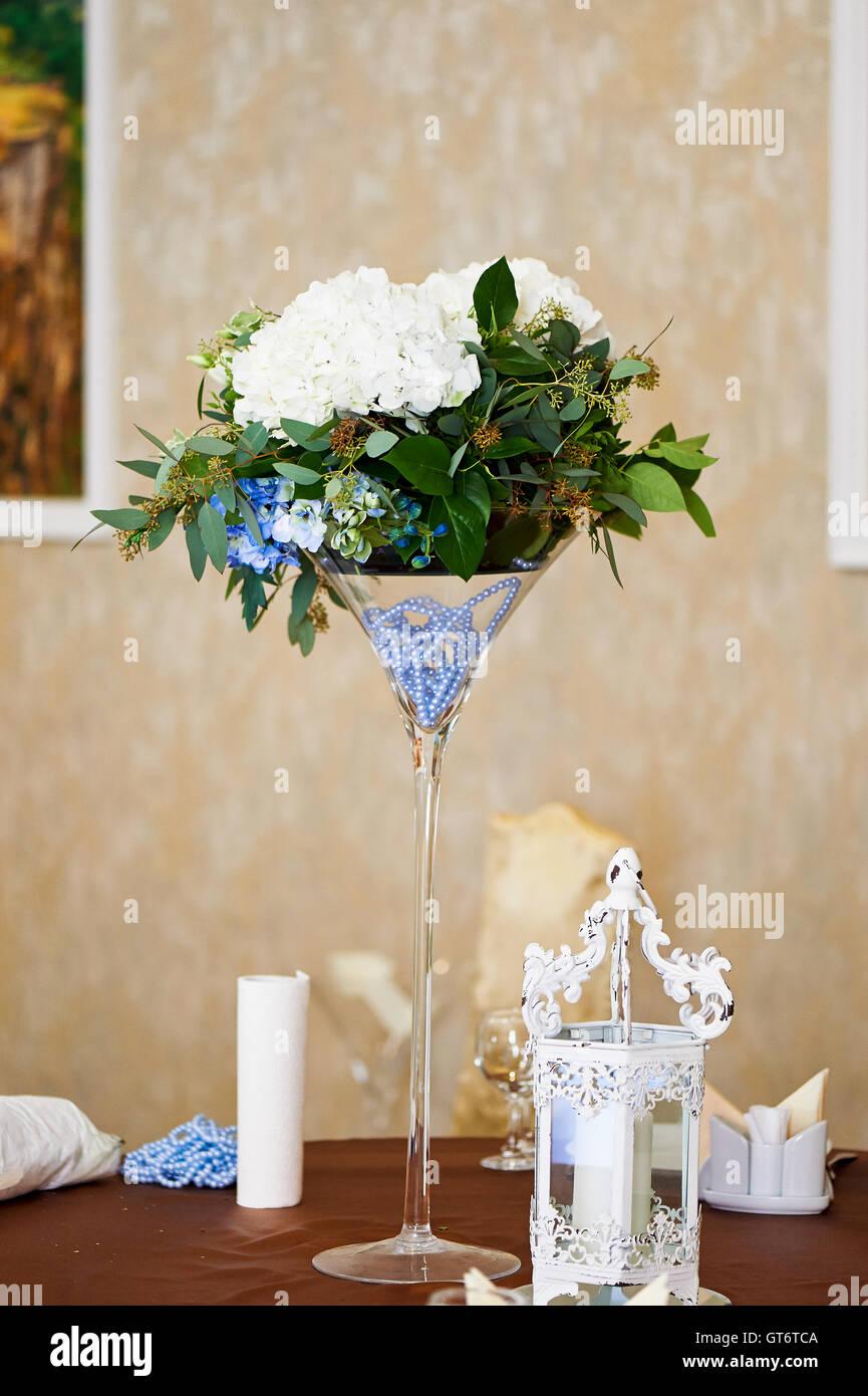 Wedding table decoration. Flowers. Hydrangea, blue beads glass Stock ...