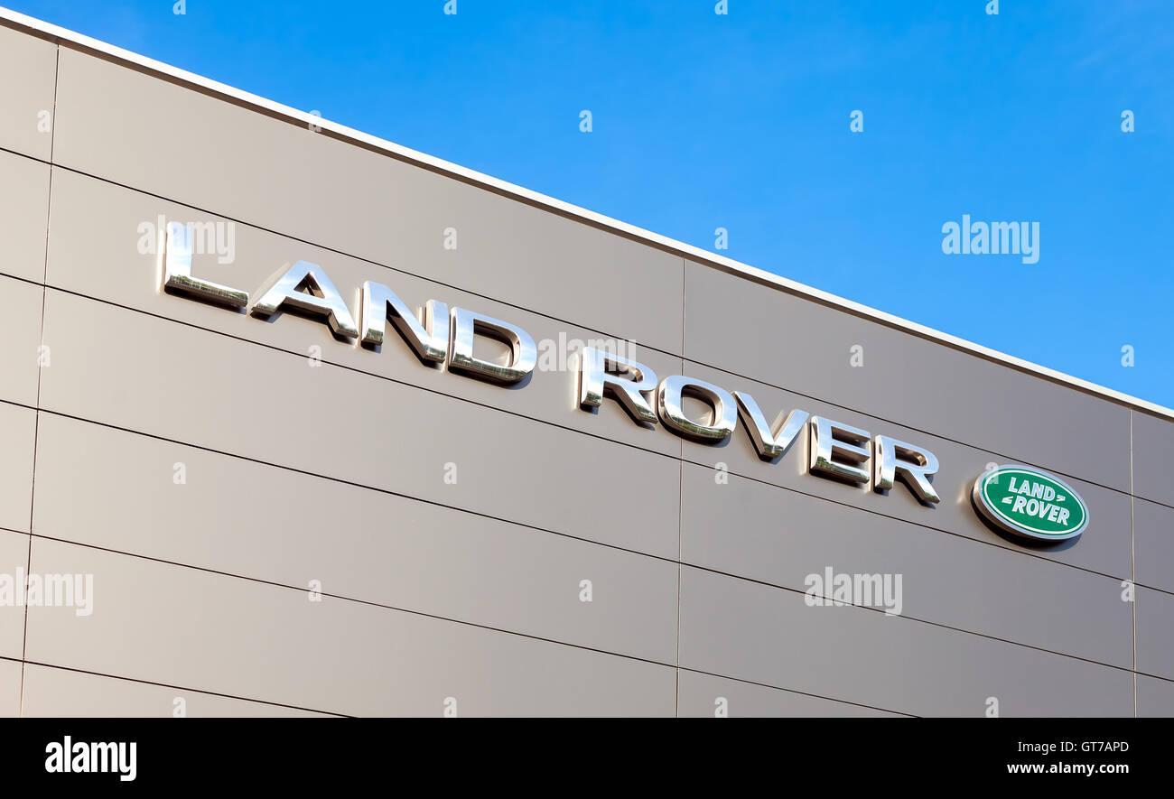 Land Rover dealership sign. Land Rover is a brand of the British car manufacturer Jaguar Land Rover - Stock Image