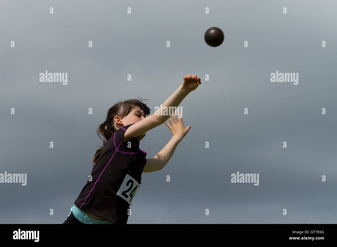 Girl with shot putt - Stock Image