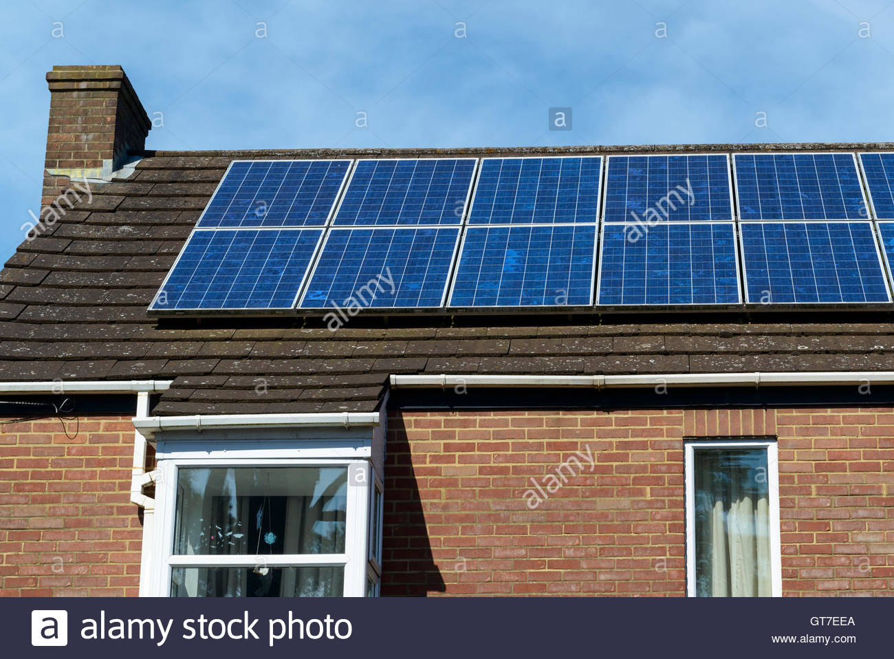 Solar panels on house roof, Salisbury, Wiltshire, England UK - Stock Image