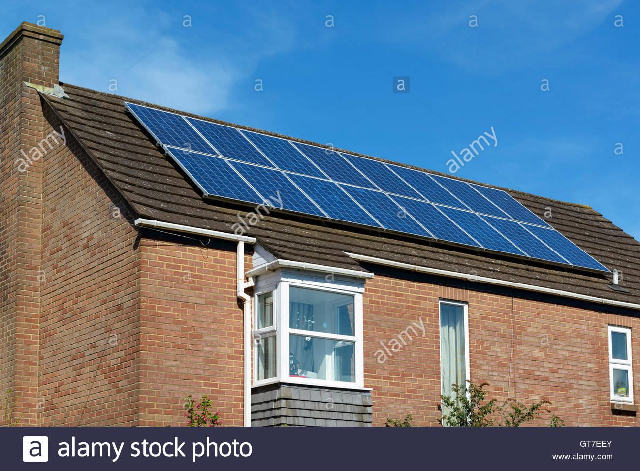 Solar panels on house roof, Salisbury, Wiltshire, England UK - Stock Image