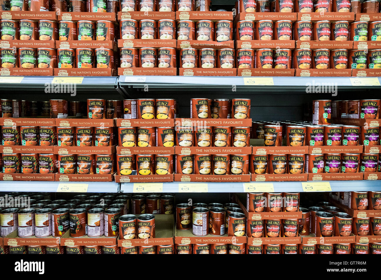 Various types of Heinz soups on display in a supermarket. - Stock Image